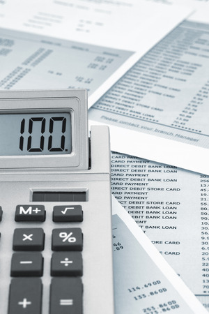 bank statement: Close up of a calculator on a bank statement