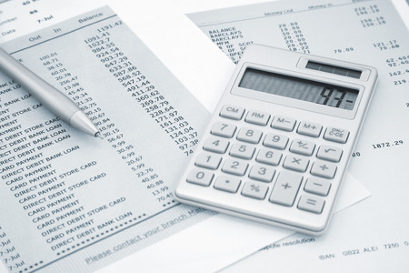 statements: Calculator and Pen on Bank and credit card statements Stock Photo