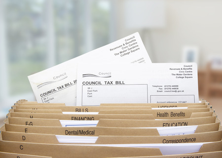 the council: home filing dividers for council tax & household bills Stock Photo