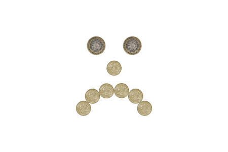 miserable: miserable face made out of one pound coins