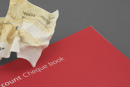 scrunched blank cheque Stock Photo