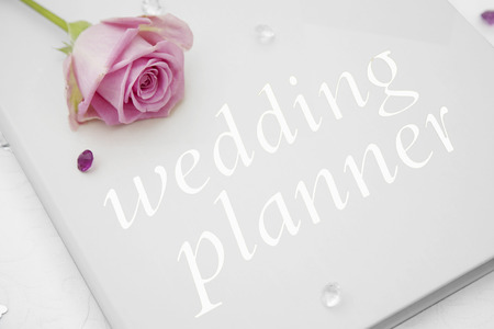 pink rose: Wedding planner book with a pink rose on top