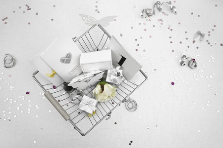 wedding favors: Wedding Favors in a shopping basket on a White tablecloth with ribbons, bows, heart confetti and small diamond table decorations