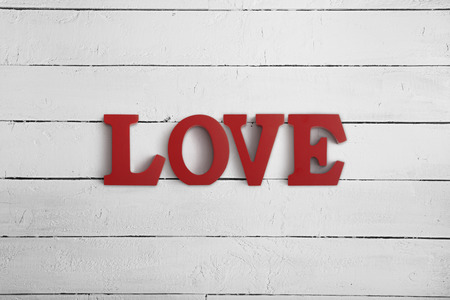 Wooden letters spelling LOVE on a wood background