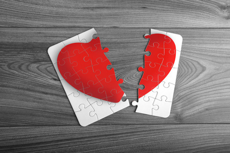 Red love heart puzzle split in two Imagens