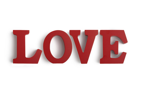 Wooden letters spelling LOVE on a white background Imagens