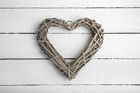 wooden love heart on a wood background