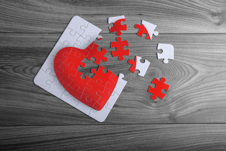 Red love heart puzzle with loose corner pieces