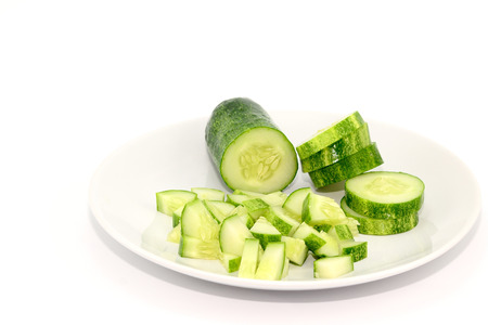 Sliced and diced cucumbers on a white plate Reklamní fotografie