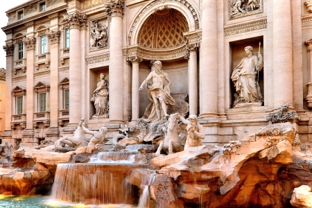 The Trevi Fountain in Rome at dusk on an overcast day. photo