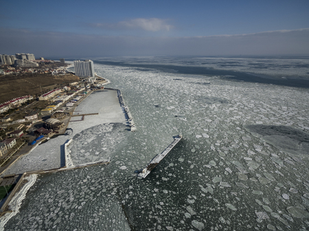 Aerial drone image of the Black Sea frozen at 12 Station Beach in Odessa Ukraine. Stock Photo
