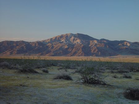 The mountains of Joshua Tree National Park reflect the evening light. photo