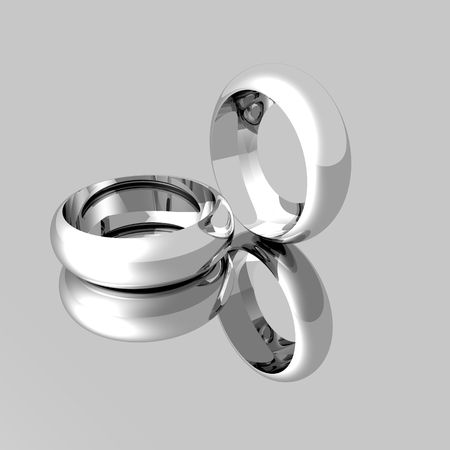 mirrored: Computer model of Platinum wedding rings on a semi mirrored surface. Stock Photo