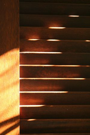 Brown shutters with dust in evening light.