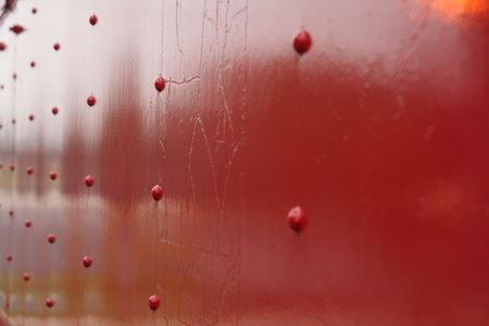 rivets: A metal wall painted red with rivets. Stock Photo