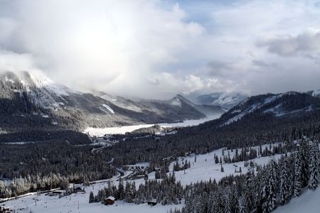 avalanche: Looking at a snow covered mountain with avalanche areas. Stock Photo