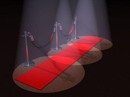 Een rode loper met stanchions en spot lights.