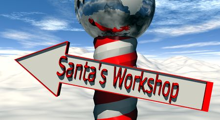 A North Pole marker with a arrow directing you to Santa's Workshop Archivio Fotografico