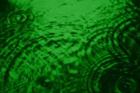 Tranquil ripples in a green liquid. Stock Photo - 3918242