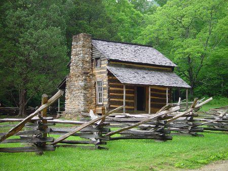 An old Appalachian cabin with a split rail fence.