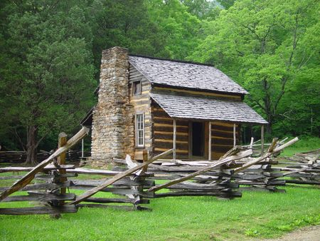 An old Appalachian cabin with a split rail fence. photo