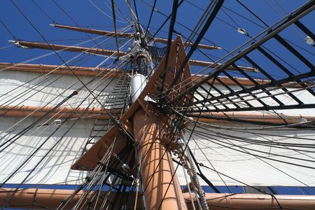 seafaring: Look up at the canvas, mast, and rigging of a tall ship sails. Stock Photo