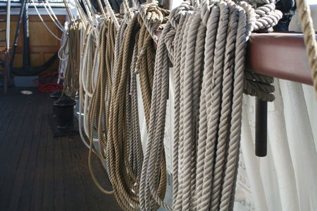 Line on a tall ship coiled and hanging on deck.