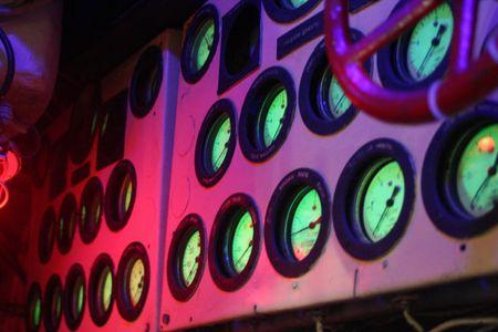 Pressure gauges glowing at night.