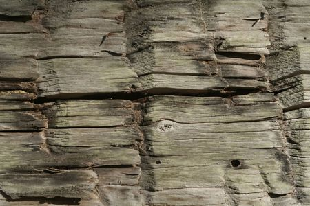 Detail of a wood beam with horizontal cracking.  Stock Photo