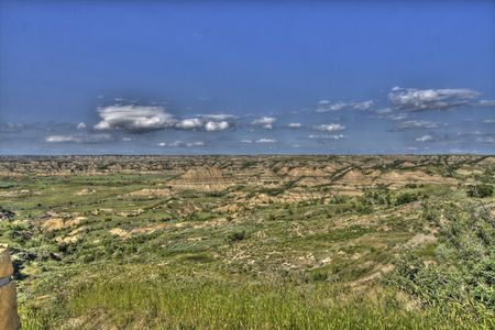 as far as the eye can see: Colorful badlands stretching as far as the eye can see. Stock Photo