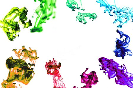 Multiple drops of colored ink forming a frame as they move through water, isolated on white.