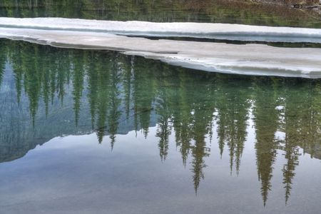 Ice floating on a cold, clear blue lake. Stock Photo - 5643065