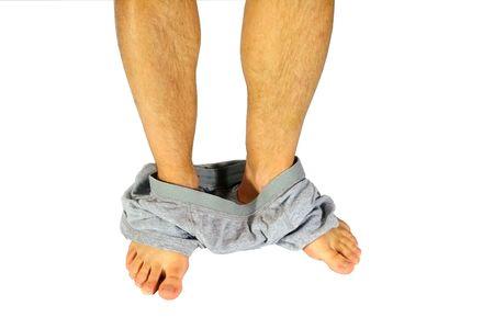 shorts: Un hombre con su ropa interior en los tobillos, aislado en blanco.