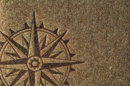 Een kompas roos bedrukt op een hout structuur met kopie spce.