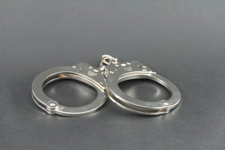 cuffs: Hand cuffs isolated with copy space.