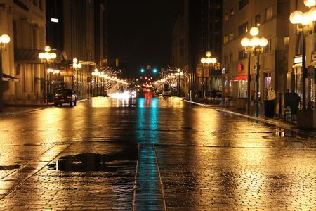 View of ciy street at night, adter rainfall with christmas lights in the trees. Stok Fotoğraf