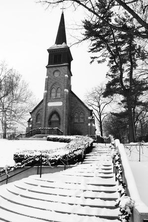 This old church sits on a hill and is blaneted by winter snow. Stock Photo - 6286437