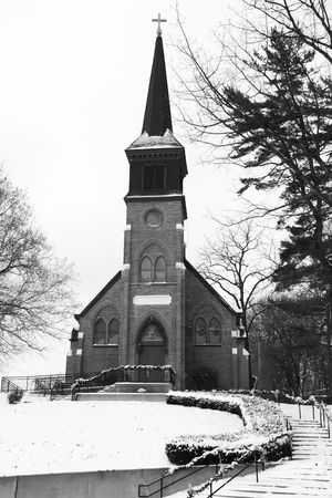 This old church sits on a hill and is blaneted by winter snow. Stock Photo - 6304830