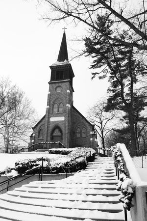 This old church sits on a hill and is blaneted by winter snow. Stock Photo - 6304831