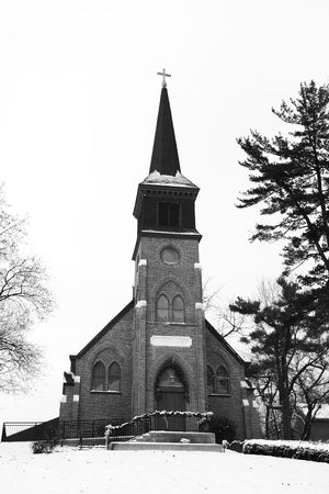 This old church sits on a hill and is blaneted by winter snow. Stock Photo - 6335486