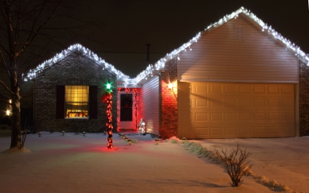 A home decorated with LED Christmas lights