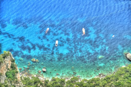 Yachts off the island of Capri and processed to appear as if they were in a painting. photo