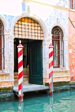 A dock along a Venice canal with a door. Stock Photo