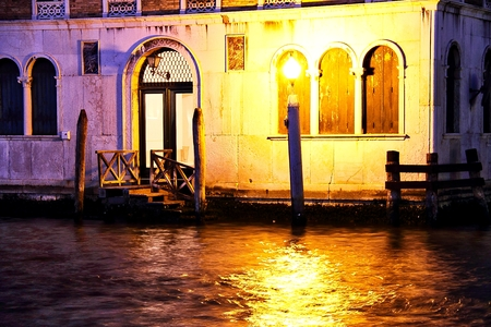 A Boat Dock And Door At Night In Venice. Stock Photo   90429699