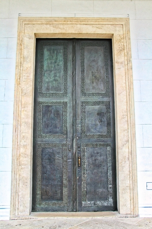 A large entryway with ornate metal doors 版權商用圖片