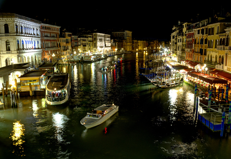 The Grand Canal of Venice, Italy along the Rialto Bridge area at night in High Dynamic Range. Stock Photo