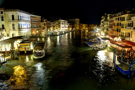 The Grand Canal of Venice, Italy along the Rialto Bridge area at night in High Dynamic Range. Editorial