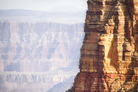 The side of a cliff in the Grand Canyon with copy space to the left.
