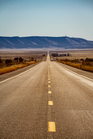 Open road in the American southwest through the state of Arizona