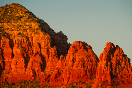 Evening light reflected on the cliff sides of the mountains of Sedona, Arizona. Zdjęcie Seryjne